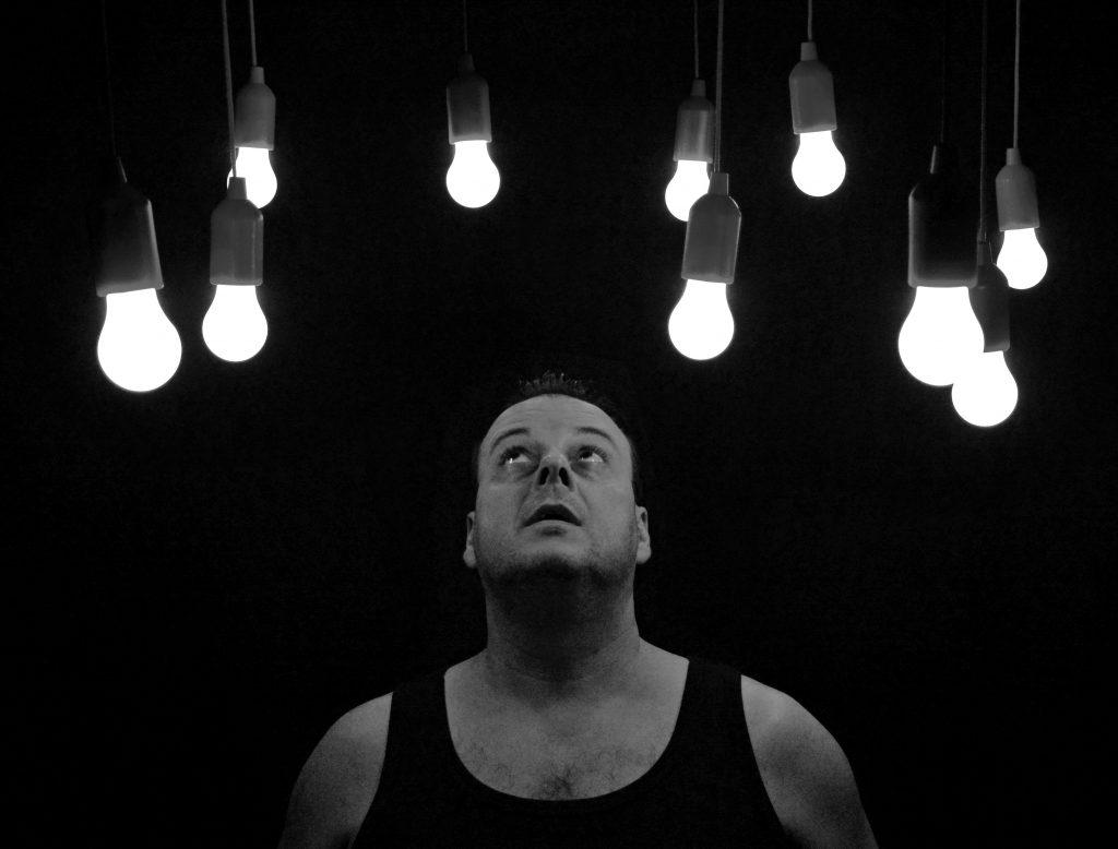 man looking at lights